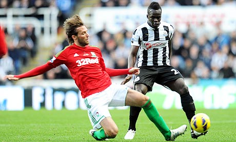 Newcastle United's Cheick Tiote and Swansea City's Miguel Michu