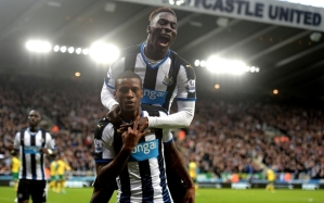 "Newcastle United's Georginio Wijnaldum celebrates scoring his side's fifth goal and completing his hat-trick with Massadio Haidara (top) during the Barclays Premier League match at St James' Park, Newcastle. PRESS ASSOCIATION Photo. Picture date: Sunday October 18, 2015. See PA story SOCCER Newcastle. Photo credit should read: Owen Humphreys/PA Wire. RESTRICTIONS: EDITORIAL USE ONLY No use with unauthorised audio, video, data, fixture lists, club/league logos or ""live"" services. Online in-match use limited to 45 images, no video emulation. No use in betting, games or single club/league/player publications."